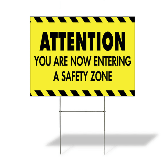 Yellow safety zone sign with black text